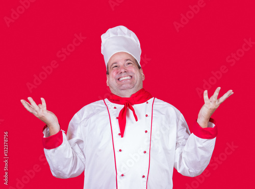 Photo  cheerful cook on a red background