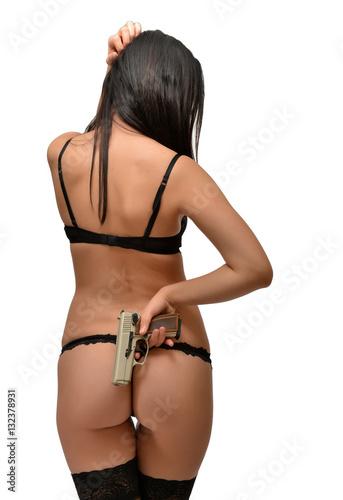 Plakat piękna seksowna dziewczyna trzyma pistolet