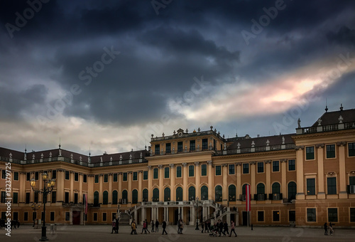 Poster Artistiek mon. Schönbrunn Palace main entrance, imperial summer residence located in Vienna, Austria with dramatic sky during sunset