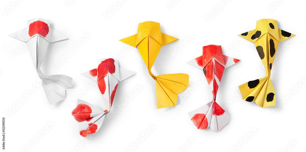 Fototapeta handmade paper craft origami koi carp fish on white background.