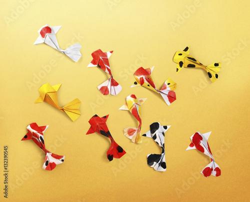 Handmade Paper Craft Origami Koi Carp Fish On Yellow Background