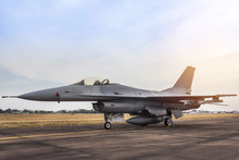 F16 Falcon Fighter Jet Military Aircraft Parked In The Runway On Sunset