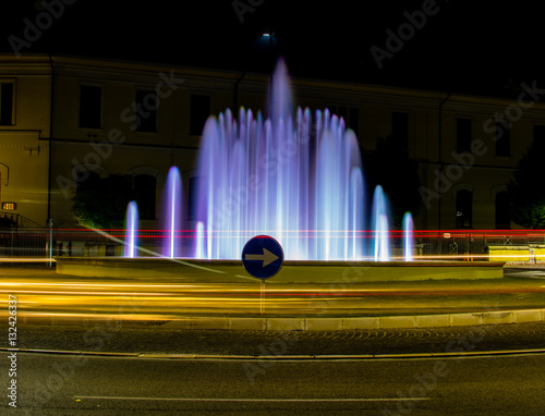 colored fountain with car light stripes Canvas Print