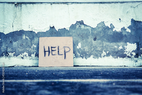 Photo Help sign paper on the grungy wall,poverty concept and ideas