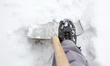 Using A Snow Shovel In A Snowe...