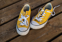 Cool Teenager Yellow Sneakers On Wooden Background