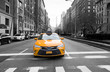 New York City taxi in yellow color in the traffic light