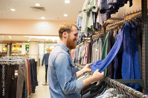 c8593e6d Young man in men's clothing store. - Buy this stock photo and ...