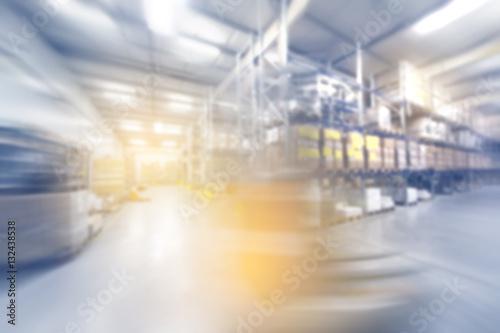 Staande foto Industrial geb. blurred warehouse interior wirh moving forklift