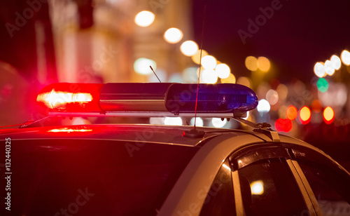 Canvas Print Red light flasher atop of a police car