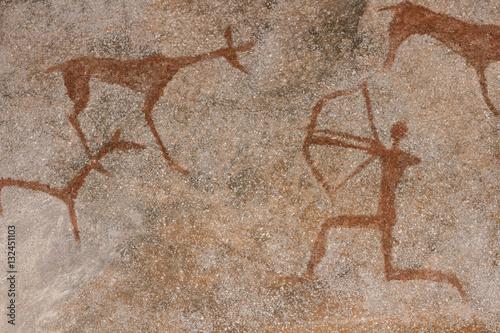Fotografie, Obraz  Drawing on a rock cave wall ocher paint, ancient prehistoric Neanderthal man