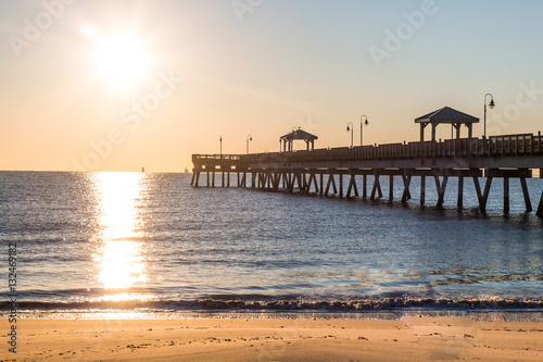 Fotografie, Obraz  Dawn's early light on the fishing pier at Buckroe Beach in Hampton, Virginia