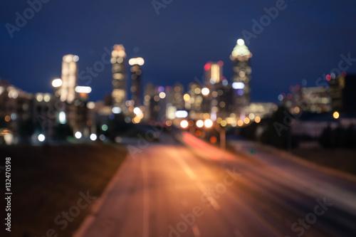 Plakat Bokeh światła nowożytna miasto linia horyzontu