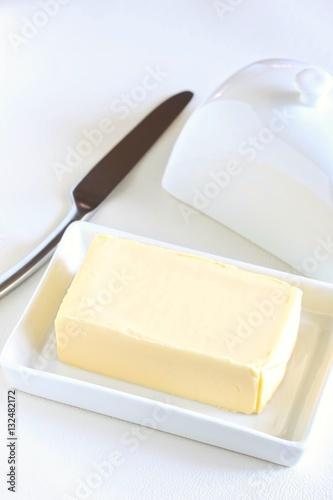 Staande foto Zuivelproducten Butter in Butter Dish