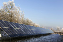 Solar Power Station In The Snowy Freeze Winter Nature
