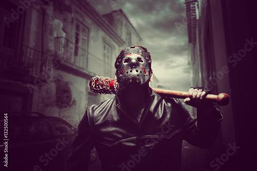 Obraz na plátně Psycho man in hockey mask with bloody baseball bat