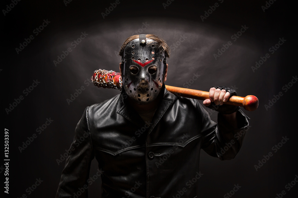 Fototapeta Psycho killer in hockey mask on black background.