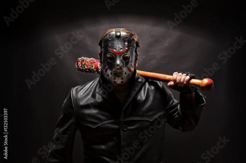 Psycho killer in hockey mask on black background. Wallpaper Mural