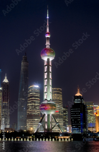 Recess Fitting Shanghai Night Shanghai skyline with Oriental Pearl Tower in the front and reflections in Huangpu river. Beautiful modern city.