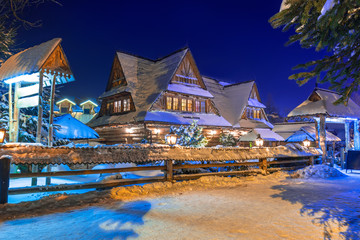 Wooden architecture of Zakopane at snowy night, Poland