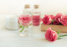 Rose Scent Holistic Cosmetic. Fresh Pink Blossom, Array Of Glass Vials And Apothecary Bottles. Flower Aromatherapy. Soft Light And Focus.