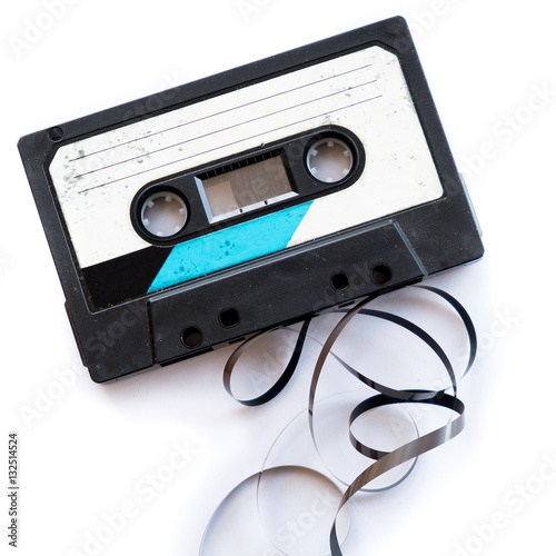 Fotografía  audio tape blank label rolled out isolated white playlist