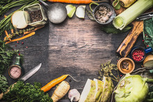 Healthy Vegetarian Cooking Ingredients For Soup Or Stew. Raw Organic Vegetables With Kitchen Tools On Dark Rustic Wooden Background, Top View. Country Style