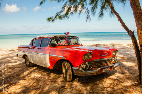Photo  American classic car on the beach Cayo Jutias, Province Pinar del Rio, Cuba