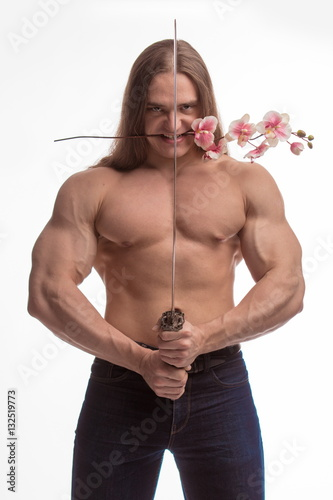 Portrait of a brutal man bodybuilder with bare-chested with long hair with a Jap Wallpaper Mural