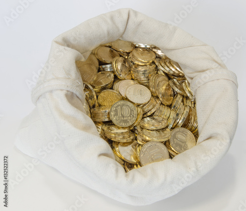 Bag of coins on a white background - Buy this stock photo