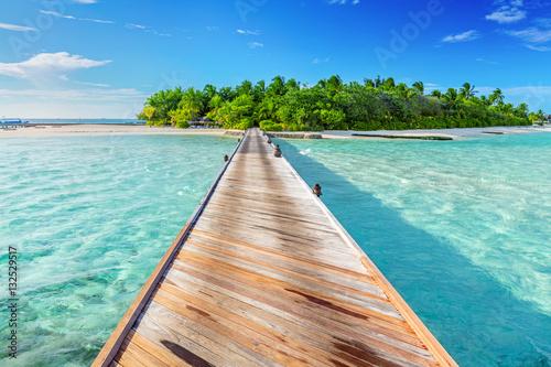 Wooden jetty towards a small island in Maldives Fototapeta