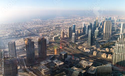 Tuinposter Aerial shot of Dubai including the Burj Al Arab hotel, a luxury