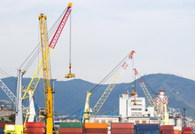 Industrial Port With Containers / Trade Port / A Big Ship Loading Cargo At Port.