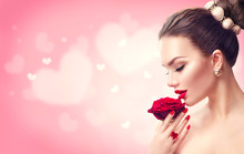 Valentine's Day. Woman With Red Rose. Fashion Model Girl Face Portrait