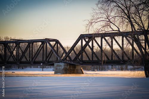 Deurstickers Bos rivier Sunset under the rail bridge