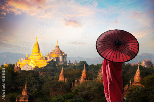 Monk standing with holding umbrella, Bagan Mandalay Myanmar Wallpaper Mural