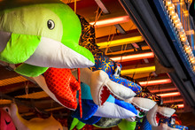 Big Soft Toys Of Dolphin And Sharks Hanging In A Shop
