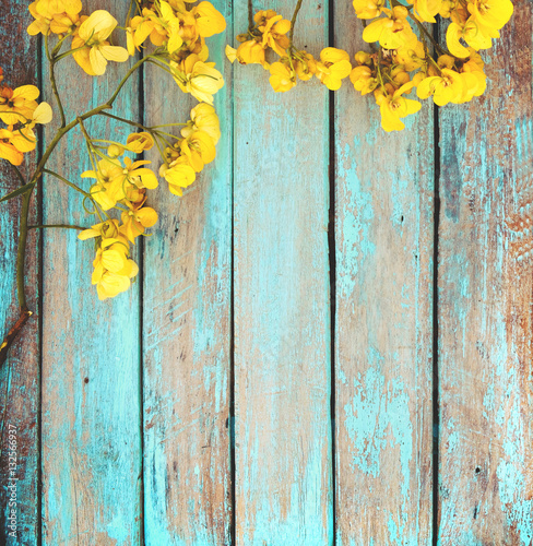 yellow flowers on vintage wooden background border design vintage color tone concept flower of spring or summer background buy this stock photo and explore similar images at adobe stock adobe stock vintage color tone concept flower