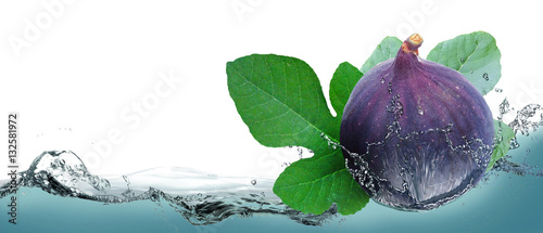 Juicy fruit figs on a background of splashing water. Canvas Print