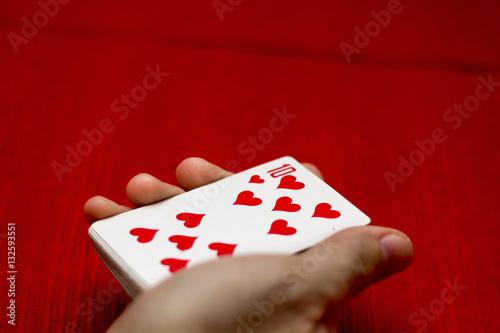 Playing cards/ red background плакат