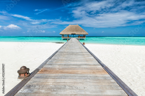 Wooden jetty leading to relaxation lodge. Maldives islands