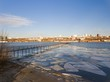Frozen old pier at river side in winter time. Aerial view.