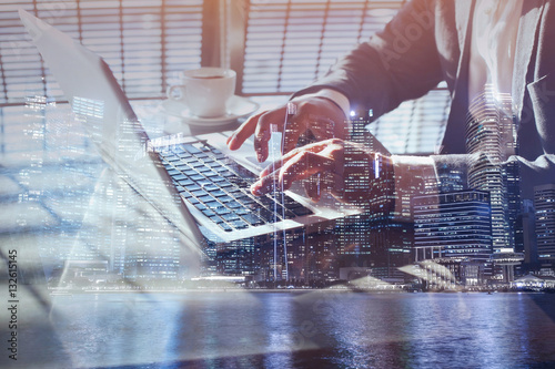 double exposure of business man working online on laptop, close up of hands, checking email or internet banking concept.