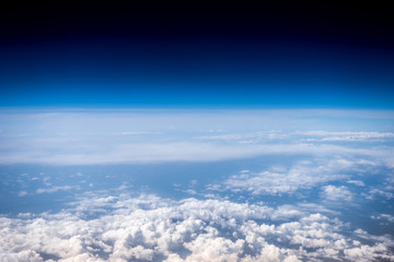 Fluffy white clouds and blue sky. Stratosphere. View from above