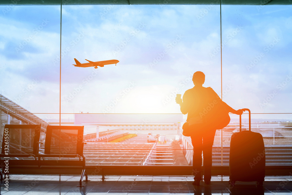 Fototapety, obrazy: happy traveler waiting for the flight in airport, departure terminal, immigration concept