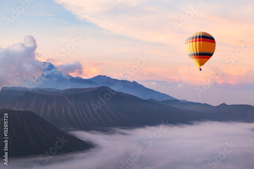 Tuinposter Landschap beautiful inspirational landscape with hot air balloon flying in the sky, travel destination