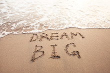 Dream Big, Motivational Sign On The Sand Of Beach