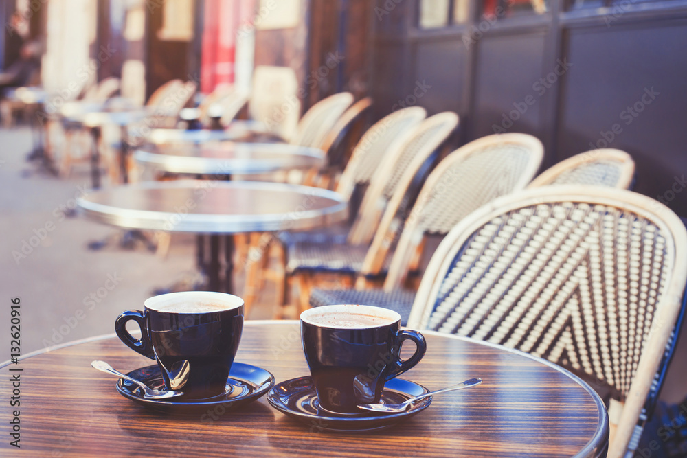 street cafe in Europe, two cups of coffee on cozy vintage terrace