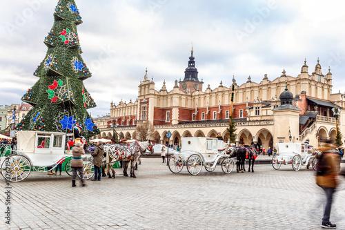 Fototapeta Fair in KRAKOW. Main Market Square and Sukiennice in the evening. obraz