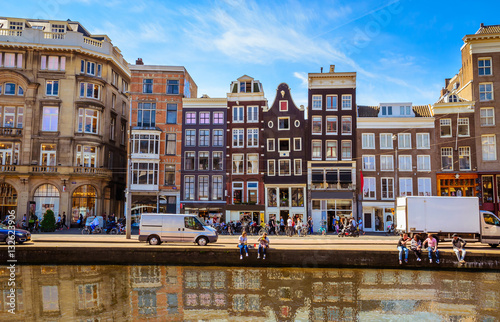 Traditional old buildings and and boats in Amsterdam, Netherlands Canvas Print